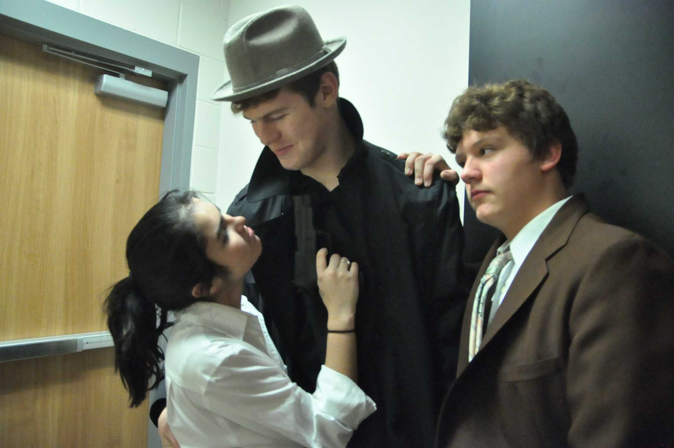 Sophomore Lani Lopez and Josh Buie get ready for dress rehearsals for