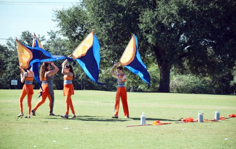 The Color Guard practices their routine in preparation for the Area Band competition.